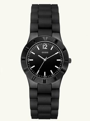 This sport watch was inspired by the guys but made for the ladies. With a slimmer construction, crystals and sleek dial with color pop accents, it's the perfect accessory for the grown-up girl who's a tomboy at heart.    • Analog function • Watch dimensions in mm: 36/36/10.7      • Brushed black ionic-plated case with black crystals  • Black dial with white accents • Black silicone bracelet • Water resistant up to 100 m/330 ft  • 10 Year Limited Warranty