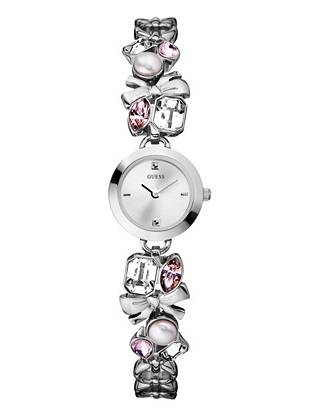 Bows, pearl beads and sparkling crystals bring a girly touch to this petite wristwatch. Try it with your ladylike-chic looks for instant elegance.      • Analog function  • Watch dimensions in mm: 21/21/7   • Silver-tone case  • Silver-tone dial   • Silver-tone,  pearl bead and crystal self-adjustable strap  • Waterpro Water Resistant  • 10 Year Limited Warranty
