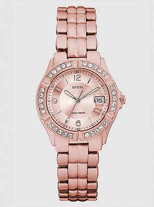 Be pretty in pink with this distinctively rose-hued watch. Its soft color and crystal accents make a high-fashion addition to everyday looks.      • Analog function with date window   • Watch dimensions in mm: 36/36/11   • Light pink aluminum and crystal case  • Light pink dial   • Light pink aluminum bracelet strap   • Water resistant up to: 100 m/330 ft  • 10 Year Limited Warranty