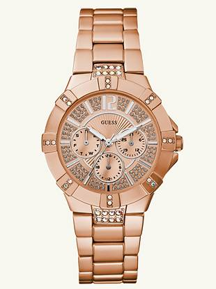 Whether you wear it alone or as a complement to layers of rose-gold jewelry, this dazzling watch definitely ups your shine factor.     • Multifunction: day, date and 24 hour international time  • Watch dimensions in mm: 41/41/14   • Brushed rose gold-tone aluminum case with crystals • Rose gold-tone dial with crystals • Rose gold-tone aluminum bracelet   • Water resistant up to 50 m/165 ft  • 10 Year Limited Warranty