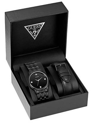 Give him the gift that defines his modern style with this two-piece watch set. Genuine diamonds and interchangeable black straps make it the timepiece he'll wear year after year.
