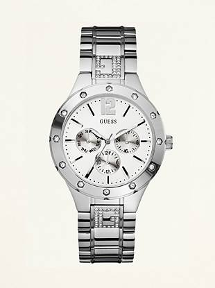 You'll keep up-to-date, both in time and in style, with this sleek and sporty silver-tone multifunction watch.       Multifunction: day, date and 24 hour international time  Watch dimensions in mm: 40/40/12          Polished silver-tone and crystal case  White dial  Brushed and polished steel bracelet  Water resistant up to 100 m/330 ft            10 Year Limited Warranty