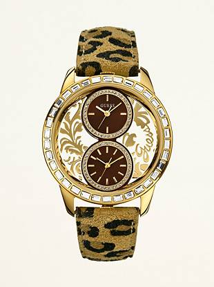 Whether you travel near or far, this sporty watch features an animal-print strap to lend an air of safari-chic to your ensembles.  Dual analog function  Watch dimensions in mm: 45/45/13          Gold-tone and crystal case  Gold-tone, crystal and clear dial  Animal-print leather strap             Water resistant   10 Year Limited Warranty