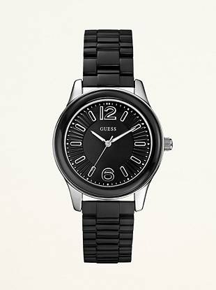 Sleek and simple makes a fashionable statement with this modern watch. Add it to your relaxed daytime looks for extra edge.     Analog function Watch dimensions in mm: 40/40/12 Polished silver-tone and black top ring Black dial Black polycarbonate bracelet Water resistant up to 50 M/165 FT 10 Year Limited Warranty