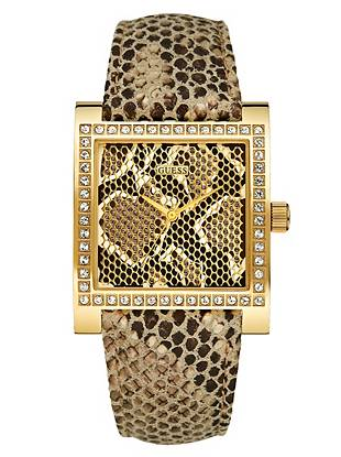 Exotic snake-inspired trends are here to stay, and this bold watch is a chic, unexpected way to work the look into your own style. Give it a try and watch the compliments roll in.      • Analog function  • Watch dimensions in mm: 37/36/10.5   • Gold-tone and crystal case • Python-embossed pattern dial with gold-tone accents   • Leather strap with python-embossed pattern and gold accents   • Water resistant • 10 Year Limited Warranty