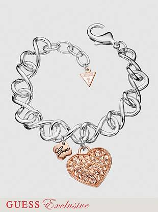 "A mixed metal charm bracelet will keep you sparkling all night long. Rose-gold tone heart with crystal detail dangles on silver-tone chain.   Lobster clasp  7 ½"" long  1"" extender  Nickel and lead free"