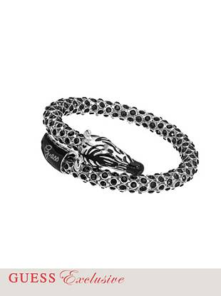 "The perfect animal motif for our latest trend favorite: Enamel and crystal accents bring extra shine to the zebra's stylish monochrome look.      • Silver-tone bracelet with zebra motif. Genuine crystals and enamel accents. • 2 ½"" diameter • Includes an exclusive drawstring jewelry pouch"