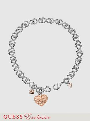 Drape yourself in sparkle with this gorgeous crystal detailed necklace. Rose gold tone heart charm dangles from thick silver-tone chain.   Lobster clasp  15
