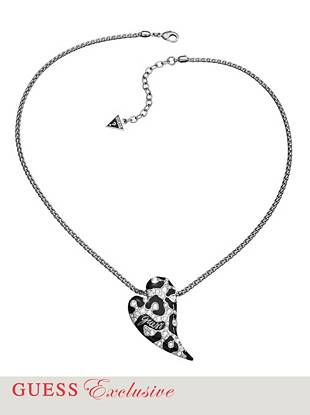 "Dial up the glamour on any look with this ultra-cool leopard-print heart necklace. Genuine inlaid crystals add just the right amount of on-trend sparkle.  •	Chain necklace with heart shaped charm pendant •	Pendant: Leopard-inspired design with enamel and crystals  •	Lobster clasp  •	18"" drop with 2"" extender  •	Includes exclusive drawstring jewelry pouch"