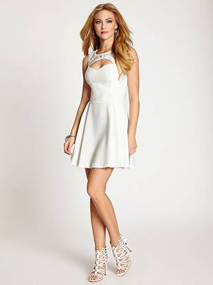 "Showcase your sweet and sexy style in this flirty cocktail dress. With a flattering fit-and-flare silhouette, sultry cutouts and sparkling embellishments, your party-perfect look is in the (shopping) bag.       • High neckline. Sleeveless. Fit-and-flare.  • Cutout detail at bust and back. Bead and rhinestone embellishments.  • Hook-and-eye closures at back of neck. Zipper closure at back. Lined at bodice.  • Measures approximately 35"" from shoulder to hem • 93% Polyester, 7% Spandex • Hand wash • Measurement taken from a size 4"