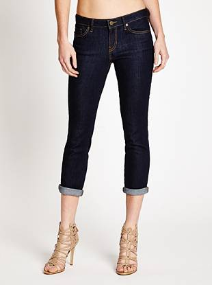 Sexy, flattering and perfect for warm weather—our beloved cropped jeans represent the best of signature GUESS style. Featuring a comfortable medium rise, sleek slim fit and skinny cropped leg opening, this super-stretch pair hugs your body in all the right places. A clean rinse leaves them with a soft feel while the retro buttons, labels and contrast topstitching add a vintage-inspired look that's in-demand right now.