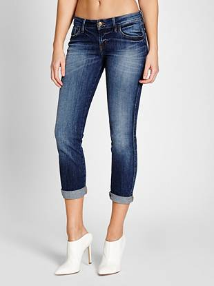 Sexy, flattering and perfect for warm weather—our beloved cropped jeans represent the best of signature GUESS style. Featuring a comfortable medium rise, sleek slim fit and skinny cropped leg opening, this mid-weight, super-stretch pair hugs your body in all the right places. They're washed to a medium indigo shade with a soft feel. Retro buttons and labels add a vintage-inspired finish that's in-demand right now.