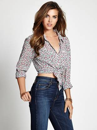 Trend-right and completely sweet, this breezy top is a  warm-weather must. Featuring an allover vintage-inspired floral print, this classic piece delivers easy, laid-back style with feminine appeal.