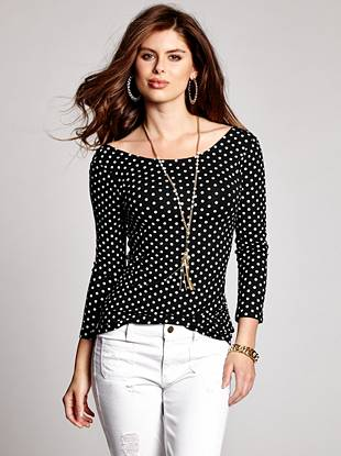 Feminine and flirty, this polka-dot top is perfect for pairing with any day or night ensemble. The low scoop back makes for a sexy surprise you'll love to show off.