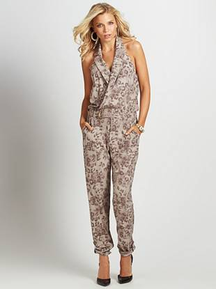 Give your summer fashion game a major upgrade with this stunningly sexy jumpsuit. A surplice V-neck, allover leopard print and button-tab ankle detail create your latest must-have look.