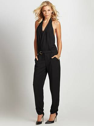 Give your summer fashion game a major upgrade with this stunningly sexy jumpsuit. A surplice V-neck, halter design and sleek silhouette fashion your latest must-have look that's meant to be seen.