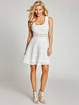 Give your summertime looks a major upgrade with this flirty dress. Allover crochet construction and a sultry crisscross back fashion your latest warm-weather must-have.