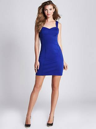Sexy back cutouts and feminine bows lend seductive allure to this curve-hugging dress. Plus, the vibrant cobalt shade puts you right on top of the trends.