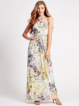 Inspired by a field of wildflowers, this stretch-knit maxi captures that effortless mood of a breezy outdoor afternoon. Easy to wear and complete with a sexy neckline, this dress is comfy and wrinkle resistant—perfect for a weekend getaway!