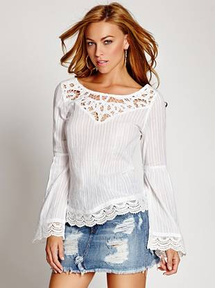 Online Exclusive Embrace spring's effortless mood with this boho-inspired peasant top. Feminine lace and crochet details make it the perfect layering piece for your beach-ready looks.