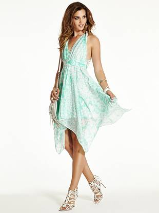 Make an impression that's both sexy and sweet in this breezy, sun-loving dress. A feminine babydoll silhouette, handkerchief hem, allover floral print and eyelet detail team up to create the ultimate casual-romantic look.