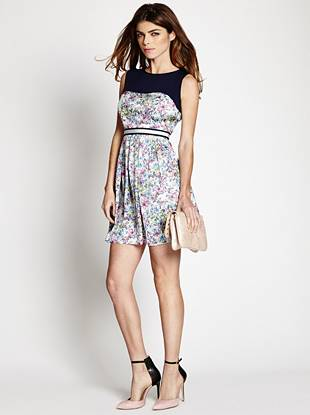 Expertly walk the line of sexy and sweet in this must-have dress. Featuring a gorgeous floral print, contrasting front and back yoke and unique ribbon-belt detail, this playful piece embraces the upbeat vibe of the season.