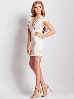 An absolute must for notice-me summer style, this body-con dress is  seriously sexy and has that boho vibe that's so right now. Featuring allover crochet construction and lace-up neckline, you'll love the summer appeal of this irresistible piece.