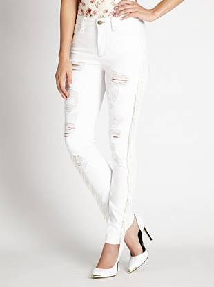 GUESS Originals Collection WHY YOU NEED IT: From our heritage-inspired GUESS Originals Collection, this sexy skinny channels the iconic look of the '80s that's totally of-the-moment. The high rise sits at your natural waist, slimming your figure and eliminating that dreaded muffin top. The lightweight stretch denim hugs your body from hip to ankle while the white shade and trend-driven fringe detail give you a retro-perfect finish.