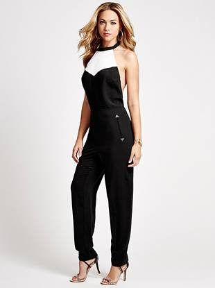 The borrowed-from-the-boys trend is taken to a whole new level with this modern halter jumpsuit. Tuxedo-inspired color-blocking makes a fashion-forward statement and the delicate design keeps things sexy.
