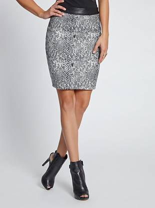 In demand and oh-so-flattering, this snake-print skirt embodies street-glam appeal. Faux-leather details bring exotic edge to the sexy, tailored silhouette.