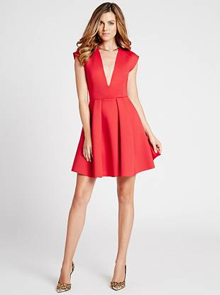 Master the so-now scuba trend with this flattering fit-and-flare dress. The deep V-neck makes a seriously sexy impression and instantly puts all the attention where it belongs...on you.