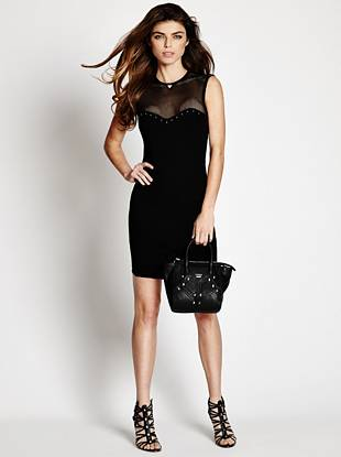 Flattering ponte knit and modern mesh detail make a sexy, daring statement with this LBD. Wear it to your next after-dark event and watch their heads turn...