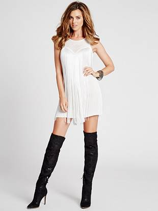 Get the season's sexy boho look with this vintage-inspired dress. Sweet crochet details bring a feminine touch to the statement-making fringe design.