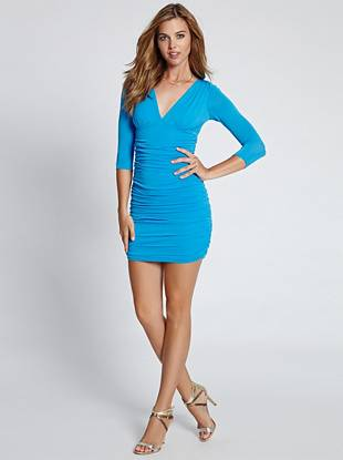 Simply sexy, this body-con dress is perfect for those times when you don't know what to wear. Soft stretch knit gives off an effortless vibe and shirred details create a flattering shape that works both day and night.