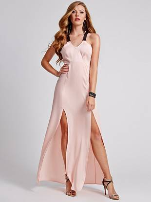 Inject instant glamour into your look with this undeniably sexy maxi dress. Double slits show off your legs and faux-leather straps add rocker-chic edge to this stunning look.