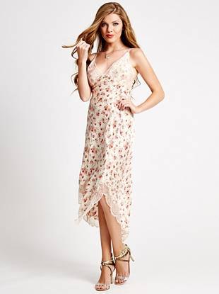 Expertly walk the line of sexy and sweet in this fall-favorite slip dress. Featuring a gorgeous floral print and delicate lace trim, this playful piece embraces the season's irresistible lingerie trend.
