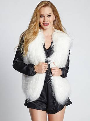 Make a fame-worthy statement by layering on this luxe faux-fur vest—it's perfect for glamming up your casual looks.