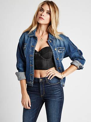 GUESS Originals Collection Channel the season's laid-back vintage vibe with this inspired denim jacket. The medium blue shade and relaxed fit give you that most-wanted '80s look while retro buttons and labels add a nod to our sexy blue jean heritage.
