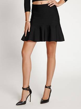 Irresistibly sexy, this fit-and-flare skirt is your new night out go-to. Stretch bandage construction hugs your curves, creating a sultry silhouette that commands attention.