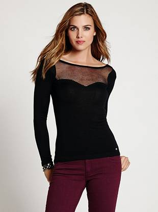Skin-revealing mesh adds a flirty touch to this super-soft knit sweater.