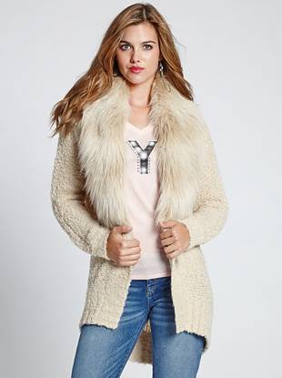 An iconic addition to your fall-to-winter wardrobe, this mixed-material cardigan keeps you warm and in style wherever you go. Soft knit blends with matching faux fur to deliver a look that's vintage inspired yet completely of the moment.