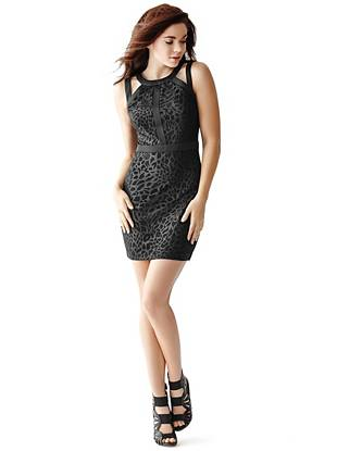 A flattering stretch fit and textured animal print make this LBD a true night-out must have. Wear it with your hair pulled back to show off the sexy open back—it's guaranteed to get noticed.