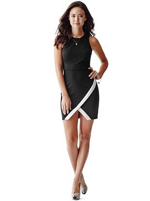 Polished with a touch of edge, this dress makes an effortless transition from day to night. The asymmetrical hem delivers sexy attitude while the contrasting trim keeps the look modern and on trend.