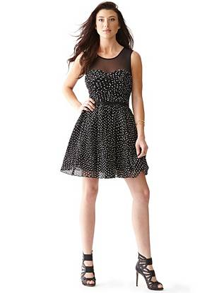Retro inspired with a modern twist, this polka-dot dress was made for the flirty fashion lover. The fit-and-flare silhouette shows off your playful personality while the sheer mesh details add that necessary touch of sexy.