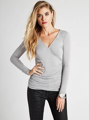 A sexy surplice V-neck and flattering shirred details make this lightweight top a basic that belongs in every fashion lover's closet.