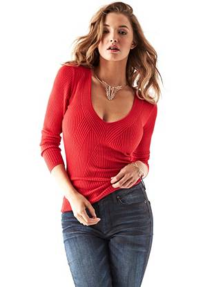 A sultry deep V-neck and super-stretch fit make this pullover the ideal layering piece for fall-to-winter months.