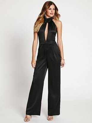 Mix things up on your next night out with this ultra-sexy jumpsuit. The deep V-neck delivers seductive allure and the flared leg keeps it contemporary.