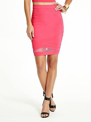 Completely modern and totally sexy, this pencil skirt is an obvious choice for your dressed-up looks. Crisscross bandage appliqué and a sporty mesh inset detail make a playful style statement.