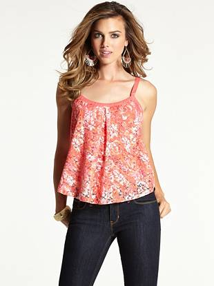 We can't help but crush on this oh-so-feminine lace top. Its whimsical, romantic design, floral print and sexy cutout back make it ideal for hot summer days and hotter summer nights.