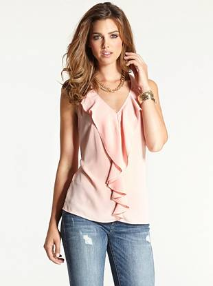 The perfect choice for daytime and nighttime looks alike, this ruffle-front top provides a flirty take on wear-everywhere basics.